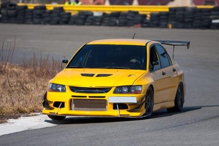 racecar: Yellow racecar on road