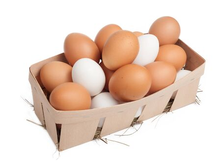 Lot of eggs isolated on white photo
