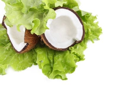 Cracked coconut on green leaf isolated on white Stock Photo - 12907143