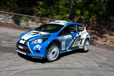 irc: Yalta, Crimea, UKRAINE - JUNE 4, 2011. IRC championship: Alex Tamrazov and Ivan German (co-driver) drives their Ford Fiesta Super 2000 during the IRC PRIME Yalta Rally 2011.