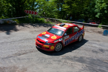 irc: Yalta, Crimea, UKRAINE - JUNE 4, 2011: Champion of Ukraine Valeriy Gorban driving his Mitsubishi EVO 9 (N4 group) at IRC Prime Yalta-Rally 2011. Ascania Racing Team Editorial