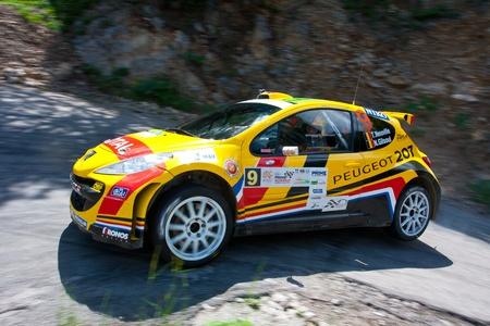 irc: Yalta, Crimea, UKRAINE - JUNE 4, 2011: Driver Thierry Neuville and his co-driver N. Gilsoul drives their Peugeot 207 S2000 during the IRC PRIME Yalta Rally 2011. IRC championship