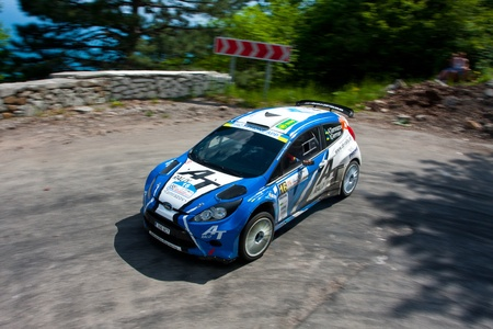 Yalta, Crimea, UKRAINE - JUNE 4, 2011: Alex Tamrazov and Ivan German (co-driver) drives their Ford Fiesta Super 2000 during the IRC PRIME Yalta Rally 2011. IRC championship