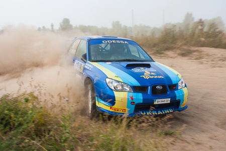 rally car: Ukraine. Kiev - August 15, 2010. The 5-th stage of the championship of Ukraine Alexandrov Rally:  Driver Chapovskiy A. and co-driver Nikolaev A. drives their Subaru WRX STI N4 group. The race in difficult conditions, very hot and dusty.