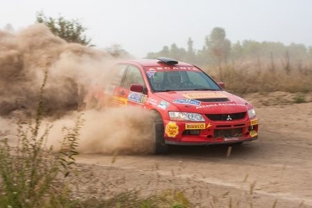 Ukraine. Kiev - August 15, 2010. The 5-th stage of the championship of Ukraine Alexandrov Rally:  O. Leonova and O. Kikireshko drives their Mitsubishi Evo 9. The race in difficult conditions, very hot and dusty.