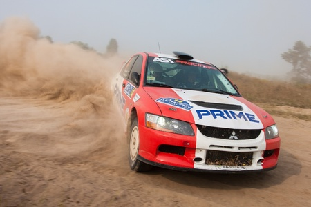 rally car: Ukraine. Kiev - August 15, 2010. The 5-th stage of the championship of Ukraine Alexandrov Rally:  Driver Petrenko Y. and co-driver Eremenko D. drives their Mitsubishi EVO 9. The race in difficult conditions, very hot and dusty.