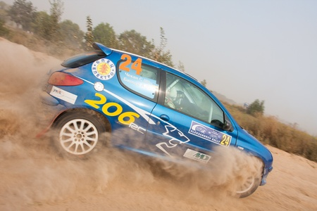 rally car: Ukraine. Kiev - August 15, 2010. The 5-th stage of the championship of Ukraine Alexandrov Rally:  Driver Chekan C. and co-driver Biloys A. drives their Peugeot 206 RC. The race in difficult conditions, very hot and dusty.