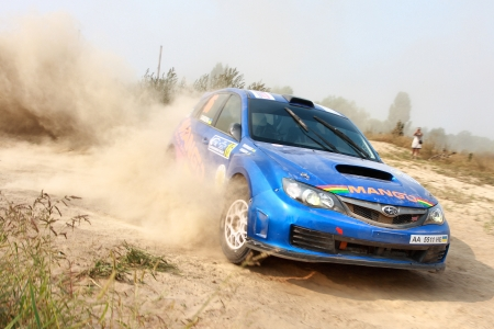 Ukraine. Kiev - August 15, 2010. The 5-th stage of the championship of Ukraine Alexandrov Rally:  Driver Patrakov and co-driver Gandzha drives their Subaru WRX. The race in difficult conditions, very hot and dusty.