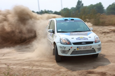 Ukraine. Kiev - August 15, 2010. The 5-th stage of the championship of Ukraine Alexandrov Rally:  Driver Fauk S. and co-driver Artemov V. drives their Ford Fiesta N4. The race in difficult conditions, very hot and dusty. Editöryel