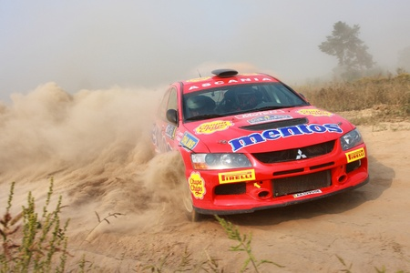 Ukraine. Kiev - August 15, 2010. The 5-th stage of the championship of Ukraine Alexandrov Rally:  Salyuk Alexander, Jr. and Evgeniy Chervonenko drives their Mitsubishi Evo 9. The race in difficult conditions, very hot and dusty.