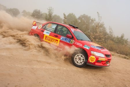 rally car: Ukraine. Kiev - August 15, 2010. The 5-th stage of the championship of Ukraine Alexandrov Rally:  O. Leonova and O. Kikireshko drives their Mitsubishi Evo 9. The race in difficult conditions, very hot and dusty.