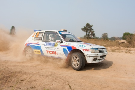 rally: Ukraine. Kiev - August 15, 2010. The 5-th stage of the championship of Ukraine Alexandrov Rally:  Driver Biloysov V. and co-driver Mankivskiy O. drives their Peugeot 106. The race in difficult conditions, very hot and dusty. Editorial