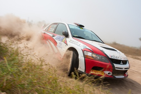 Ukraine. Kiev - August 15, 2010. The 5-th stage of the championship of Ukraine Alexandrov Rally:  Driver Koval S. and co-driver Kochmar U. drives their Mitsubishi Evo 9. The race in difficult conditions, very hot and dusty.