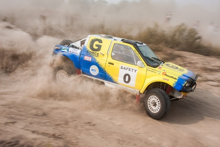 Ukraine. Kiev - August 15, 2010. The 5-th stage of the championship of Ukraine Alexandrov Rally:  Driver Bogdan Novitskiy and co-driver Vladimir Evtyekhov drives their off-road car. The race in difficult conditions, very hot and dusty.