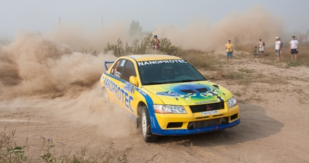 rally car: Ukraine. Kiev - August 15, 2010. The 5-th stage of the championship of Ukraine Alexandrov Rally:  Driver Nikolai Sobolev and co-driver Tatiana Kravtsova drives their Mitsubishi Evo 8. The race in difficult conditions, very hot and dusty.