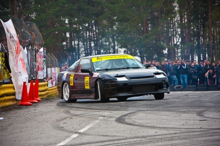 KIEV, Ukraine - April 24, 2010. The final stage of Ukrainian Championship Drift D1UDF. The driver of black Nissan 200sx drifting on the track.