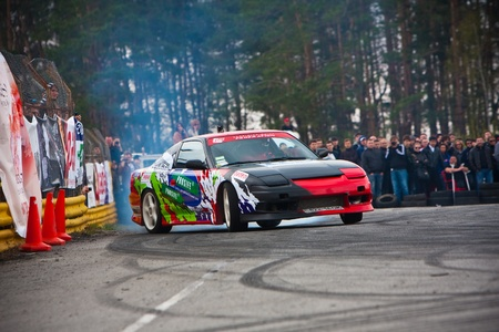 KIEV, Ukraine - April 24, 2010. The final stage of Ukrainian Championship Drift D1UDF. The driver of Nissan 200SX drifting on the track. Autodrome Chaika in Kiev.