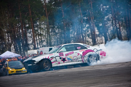 KIEV, Ukraine - April 24, 2010. The final stage of Ukrainian Championship Drift D1UDF. The driver of white Nissan drifting on the track. Autodrome Chaika in Kiev. Publikacyjne