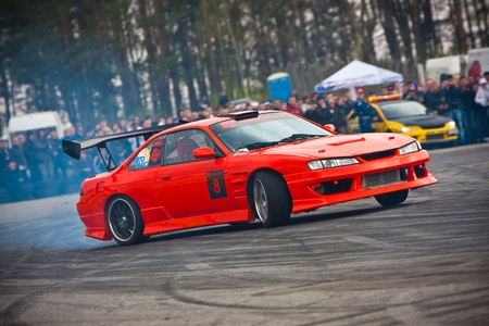 KIEV, Ukraine - April 24, 2010. The final stage of Ukrainian Championship Drift D1UDF. The driver of red Nissan Silvia drifting on the track. Autodrome Chaika in Kiev. Publikacyjne