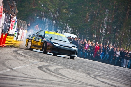 KIEV, Ukraine - April 24, 2010. The final stage of Ukrainian Championship Drift D1UDF. The driver of black Nissan 200sx drifting on the track.