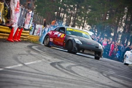 KIEV, Ukraine - April 24, 2010. The final stage of Ukrainian Championship Drift D1UDF. The driver Grinya (UKR) of black Nissan 350z drifting on the track. Autodrome Chaika in Kiev. 에디토리얼