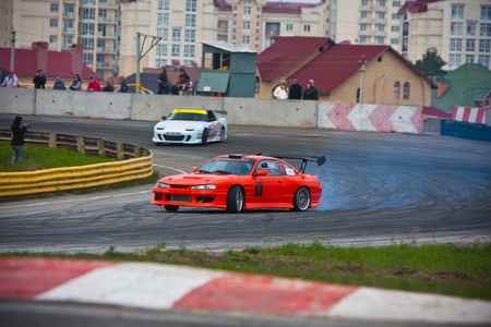 KIEV, Ukraine - April 24, 2010. The final stage of Ukrainian Championship Drift D1UDF. The driver of red Nissan drifting on the track. Autodrome Chaika in Kiev.