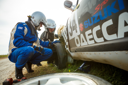 ODESSA, UKRAINE - APRIL 17: Saifudinov Alex repair his damaged car Suzuki Swift at the 1-st stage