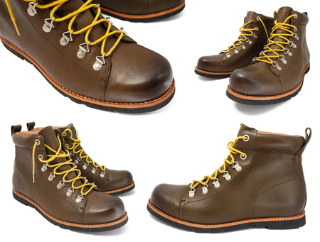 Brown leather shoes with yellow laces isolated on white