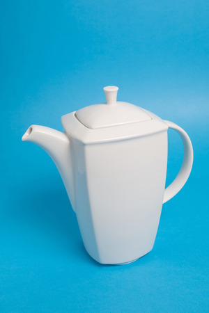 White kettle on blue background