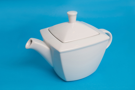 White kettle on blue background