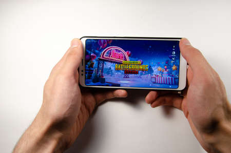 April, 2019. Kramatorsk, Ukraine. The gameplay of the game PUBG G Mobile on a white smartphone in hand