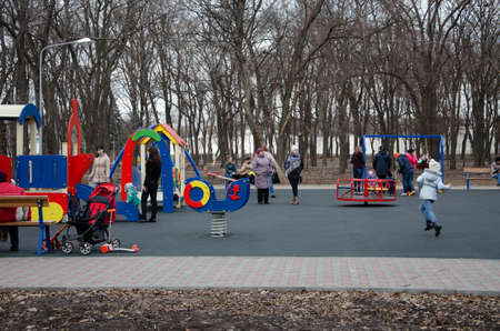 March 2019, Ukraine, Kramatorsk. Children play on the playground, rides in the park during the day