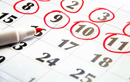 The numbers on the calendar are circled in red in macro. Calendar for plans, notes, meetings. Business calendar. Marker for notes on the calendar. In the foreground