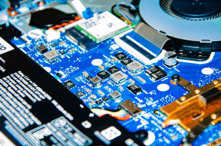 January 2020. Kramatorsk, Ukraine. The inside of a laptop in close-up. CPU, cooling, acb. Repair equipment. Pliers, wire cutters. service with male hands Stock fotó