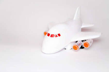 Airplane and dollars on a white background. Passenger airplane model on dollars and nearby. Business, air travel. Top and side view. Copy Space Standard-Bild - 143293419