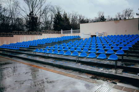 Blue benches, seats, in an open-air summer cinema under the open sky. Bench of fans, fans, webinars.