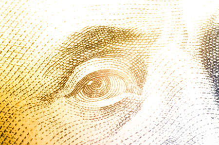 100 dollars banknote in macro. Great approximation. Eye, Franklin's face on a 100 dollar bill. Flare flare Imagens