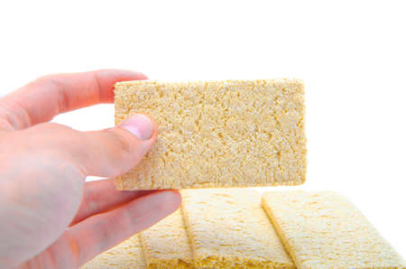 Loafs for weight loss. Crispbread for diabetics. Sugar-free bread. Dietary bread rolls on a white background. Bread rolls are stacked, heaped, a pyramid in a man's hand