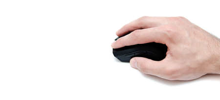 A male hand holds, controls, presses a wired black gaming mouse on a white background. The mouse is wired and wireless with additional side keys. Matte finish. Hand and mouse in macro and general plan