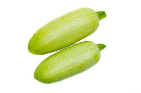Young light green zucchini, organic natural on a white background. Zucchini sideways, on top. Two zucchini, zucchini tails