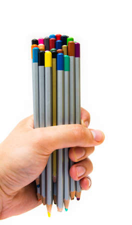 Top of the pencil. The male hand holds a bunch, a bunch, a bunch of multi-colored pencils on a white background. Very full pencils