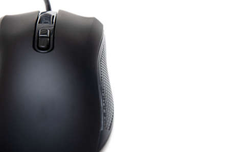 Black gaming mouse with side extra keys and a matte finish on white background. Mouse view from the back under the brush. The mouse in macro, the keys and the wheel are viewed from a person at an angle