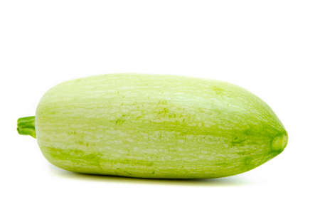 Young light green zucchini, organic natural on a white background. Squash sideways, top