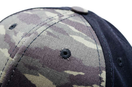 Men's two-tone cap on a white background. The baseball cap is black at the back, front and visor of the military workshop, khaki camouflage. Men's black cap with camouflage in macro. Side view, stern, top. Cap closure, button on top, ventilation hole