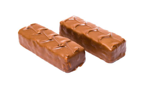 Two small snickers bars weighing 50 grams without packaging in macro are lying next to each other. Snickers two sticks, chocolates