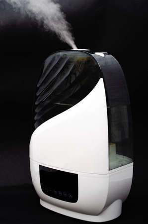 Humidifier on a black background. Humidifier overall plan and macro. The device is face and sideways. Steam water in macro. Black navigation bar, humidifier controls white touch mode keys. Mine, steam compartment, entrainment, process