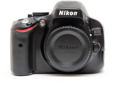 June 2020. Kramatorsk, Ukraine. Nikon D5100 SLR camera on a white background. Matrix, mirror on a camera in macro. Controls Nikon camera in macro