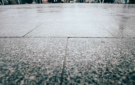 Tiles in the square of the city. Marble Flooring. The central square of the city. Wet asphalt.