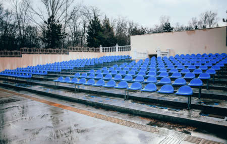 Blue benches, seats, in an open-air summer cinema under the open sky. Bench of fans, fans, webinars. Stock fotó