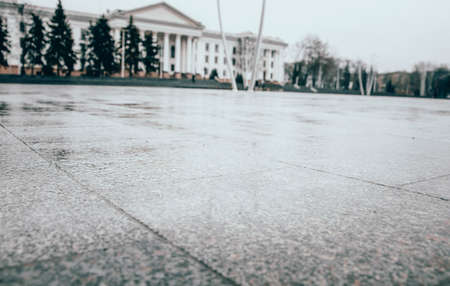 Tiles in the square of the city. Marble Flooring. The central square of the city. Wet asphalt. 写真素材 - 150710658